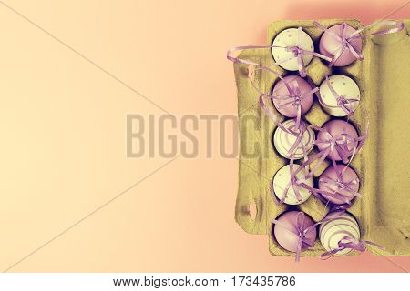 Pastel Toning. Easter or Spring Food Concept. Fresh Eggs in Box for Eggs on Pink Pastel Background. Top View.