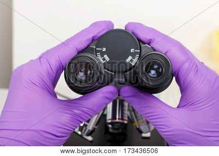 Close up photo of medical laboratory microscope optical lens