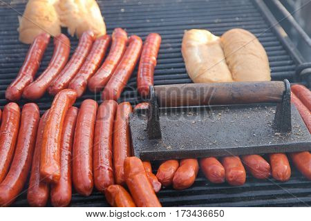 The process of making a hot dog. Delicious sausages.