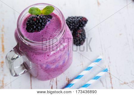 Blackberry jogurt smoothie in glass jar, copy space