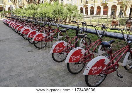 Barcelona Spain - February 25 2017: A row of bicycles in the exchange program Bicing bike community in Barcelona People can rent bicycles for short trips reducing traffic and pollution.