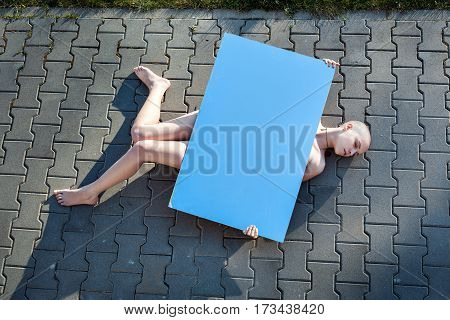 Woman lying on the pavement with no signs of life.