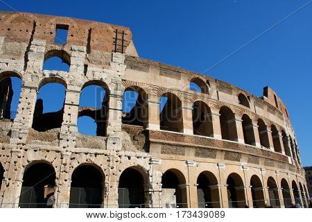Coloseum against bright bluse sky in Rome Italy