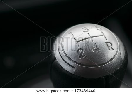 Abstract view of a gear lever, manual gearbox, car interior