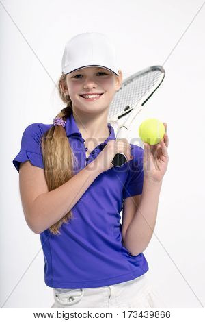 Pretty girl tennis player posing with racket white background in studio