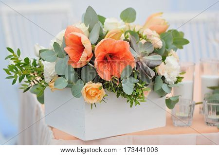 Wedding flowers decoration in white wooden box, in green, orange and peachy colours