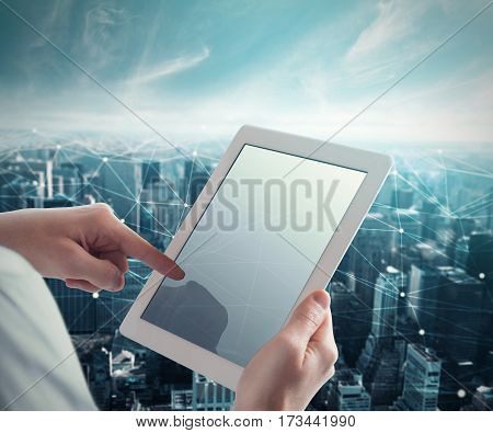 Man touches the tablet with a net of interconnection spheres connected each other. System of network