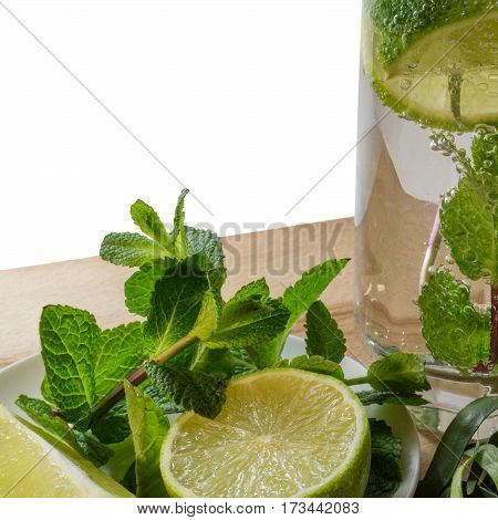 Non-alcoholic mojito with a slice of lime mint and estragon in a glass with gas bubbles