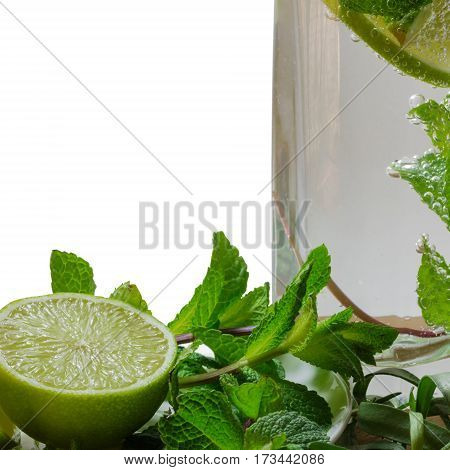 cocktail mojito with a slice of lime mint and estragon in a glass with gas sparkles