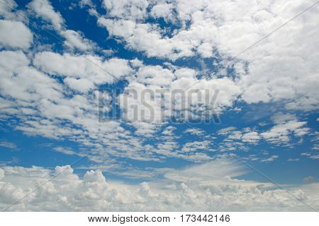 Bright white clouds on a background of dark blue sky.