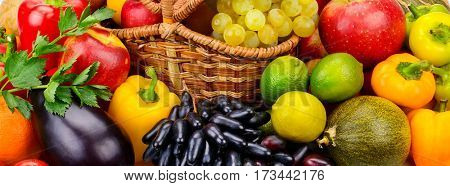 Basket with fresh fruits and vegetables. The top view.