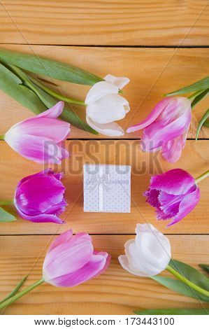 Bouquet Of Tender Pink Tulips With Gift Box On Light Wooden Background
