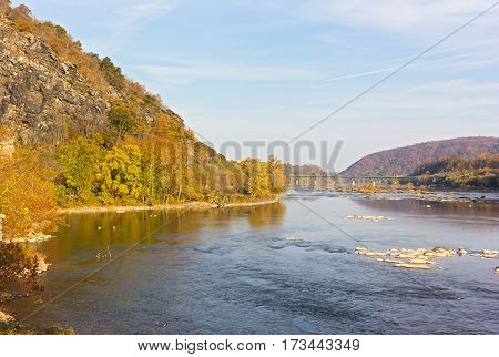 Potomac River in Harpers Ferry National park West Virginia USA. Autumn landscape with river and mountains.