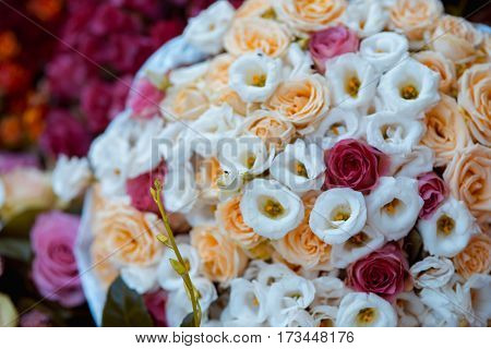 close up on white and red roses wedding bouquet top view.
