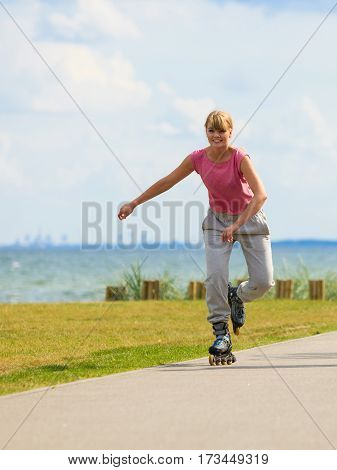 Girl Skating Alone On Seafront.