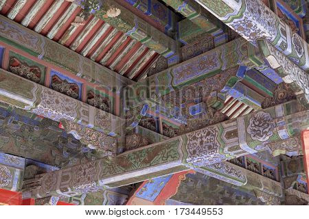 BEIJING - FEBRUARY 23:  An ornate painted ceiling on a building in the Forbidden City in Beijing, China, February 23, 2016.