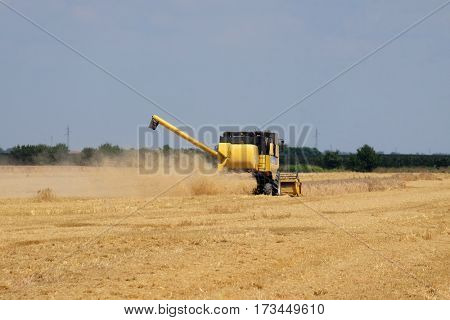 NEDELISCE, CROATIA - JULY 02, 2016: Combine harvester harvest ripe wheat on a farm in Nedelisce, Croatia on July 02, 2016