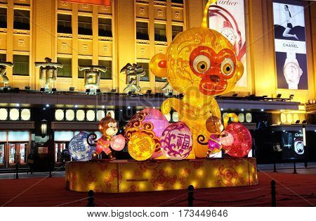 BEIJING - FEBRUARY 23: The Chinese new Year of Monkey set up in front of the luxury shopping mall at downtown in Beijing. Just before the Spring Festival and Chinese new year, February 23, 2016.