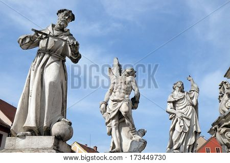 MARIBOR, SLOVENIA - APRIL 03: Saints Francis of Assisi, Sebastian and James statue, Plague column at Main Square of the city Maribor in Slovenia. Historical religious sculpture, April 03, 2016.