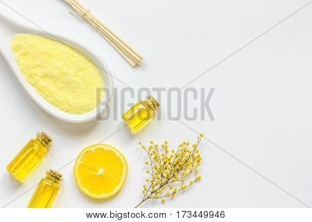 Natural cosmetic seasalt for homemade spa and organic aroma oil on white background top view mock up
