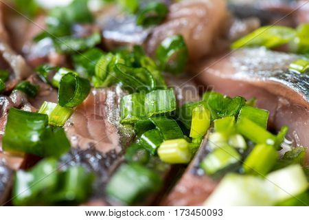 Sliced herring with onions on a cutting board