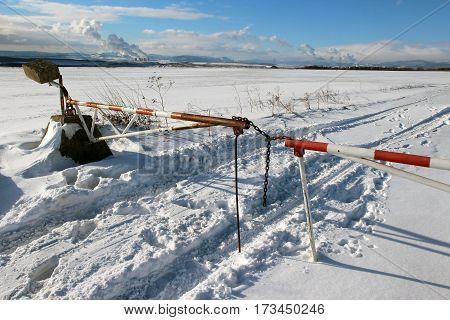 steel barrier on rural road no entry