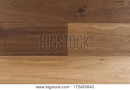 Top view photo of rustic smoked and natural oiled german oak wood floor boards with rough texture