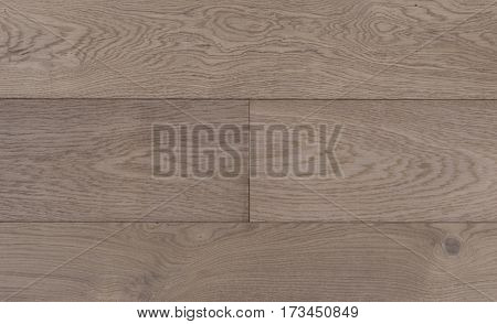 Top view photo of old vintage rustic smoked and white oiled german oak wood floor boards with rough texture
