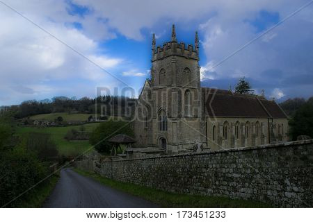 Church in the center of English village in Wiltshire count.