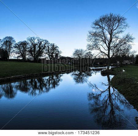 View of the pond in one of the English countryside.Wiltshire.