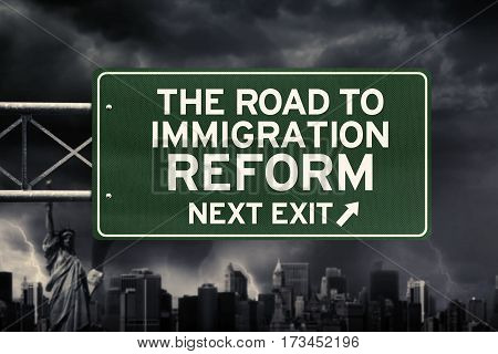 Picture of signpost with text of the road to immigration reform and arrow symbol under dark cloud