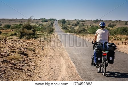 Woman on a cycle touring trip in rural part of India