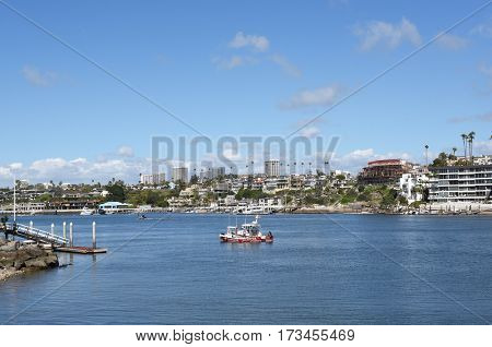 NEWPORT BEACH, CALIFORNIA - FEBRUARY 22, 2017: Newport-Avalon Channel seen from the Balboa Peninsula looking towards the Corona Del Mar Bend.