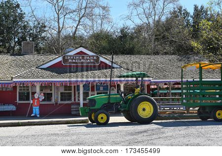 ORANGE, CALIFORNIA - FEBRUARY 24, 2017: Irvine Park Railroad and Hay Ride Tractor. The 1/3 scale train takes adults and children on a scenic ride through the Regional Park.