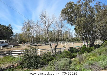 ORANGE, CALIFORNIA - FEBRUARY 24, 2017: Riding Ring at the Peacock Hill Equestrian Center in Irvine Regional Park, Orange County, California. Seen from Santiago Creek Hiking Trail.