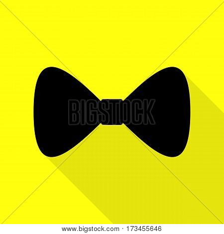 Bow Tie icon. Black icon with flat style shadow path on yellow background.