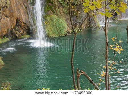 Plitvice lakes national park, waterfall, autumnal twilight, purposely blurred, selective focus