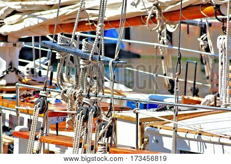 Ships Rigging:This close-up of part of a ships rigging is colorful and shows many of the different nautical knots used for tying the ships ropes.
