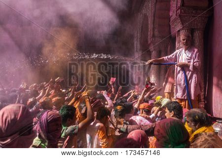 Vrindavan, India. March 22, 2016. Holi celebration in the Hindu Banke Bihare temple in Vrindavan, Uttar Pradesh, India.
