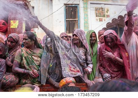 Barsana, India - March 17, 2016: Indians widows celebrate Lathmar Holi in Barsana village, Uttar Pradesh, India.