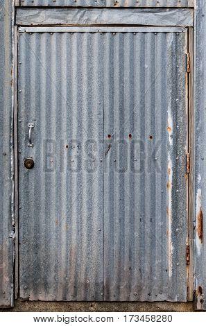 Corrugated Metal Door entrance to an industrial bulding