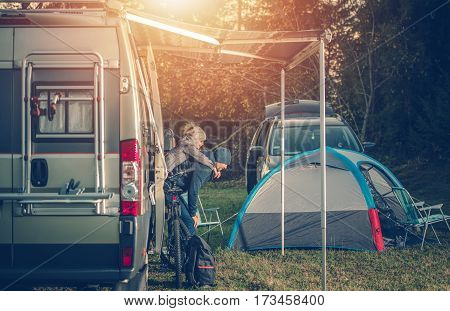 Camping Family Time. Father Playing with His Daughter Around Camper Van RV and Tents. Family on the Campground.