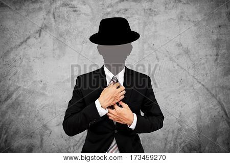 Businessman with hat, on concrete texture background