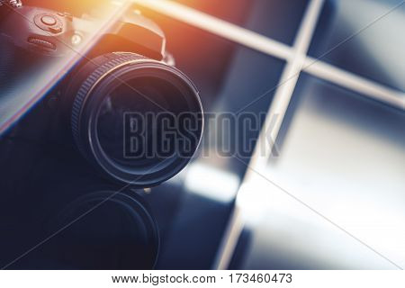 Photography Business Concept. Modern Digital Camera in the Photo Studio. Closeup Photo. 85mm Portrait Lens.