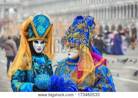 VENICE, ITALY - FEBRUARY 17, 2017: Unidentified person with Venetian Carnival mask in Venice, Italy on February 2017.