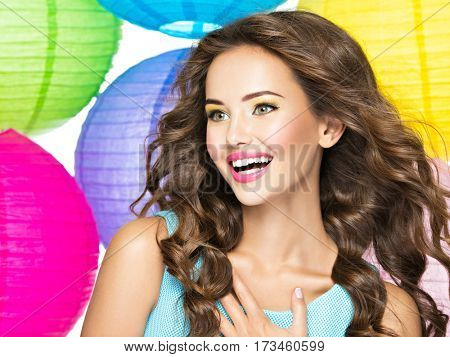Portrait of happy young girl with long brown hair. Closeup face of a  caucasian pretty smiling woman over white background