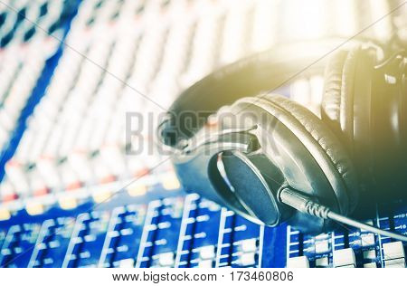 Recording Studio Headphones on the Audio Mixer Board. Closeup Photo. Music and Show Business Concept.