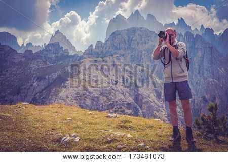 Senior Nature Photographer with Passion. Men in His 50s Taking Nature Images in the Scenic Region of Italian Dolomites.