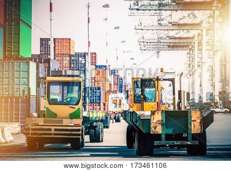 Forklift Tractors in Shipping Cargo Hub. Shipping Containers Distribution. Logistic and Shipping.