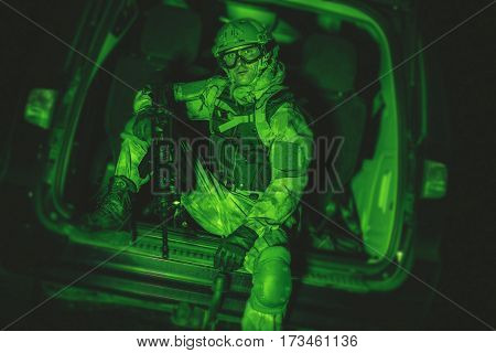 Soldier in the Van. Night Vision Color Grading. Military Technologies.